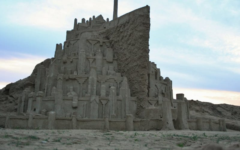 Massive sandcastle Minas Tirith awaits the approaching onslaught of waves