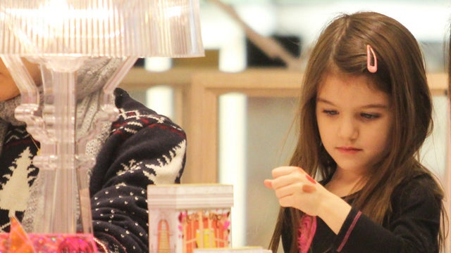 Suri Cruise Is Intent On Finding Just The Right Shade Of Lipgloss