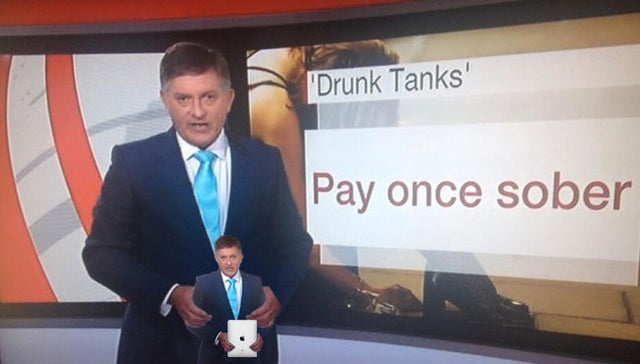22 Photos of a Reporter Holding Inappropriate Things That Aren't iPads