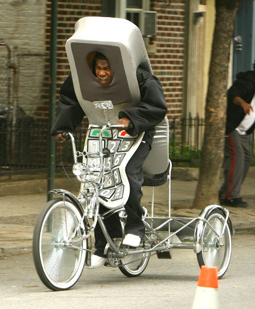 Here Is Tracy Morgan Riding a Giant Tricycle Dressed as a Cellphone