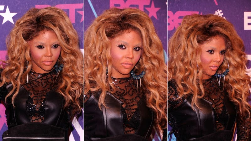 Lil' Kim Thinks You Guys Are Being Way Too Hard on Chris Brown (Updated)