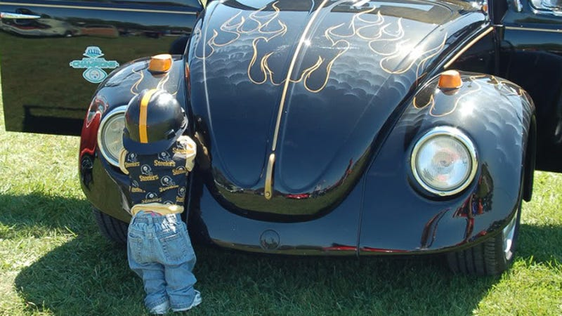 Why do car collectors put creepy dolls on their bumpers?