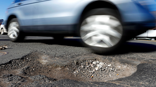 Attention SUV Drivers: Stop Avoiding Potholes