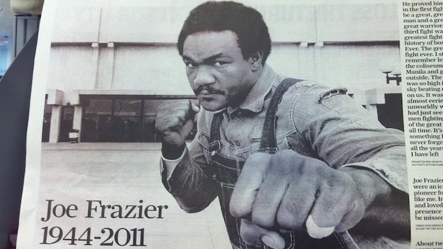 Paper Illustrates Joe Frazier Tribute With Massive Photo Of George Foreman
