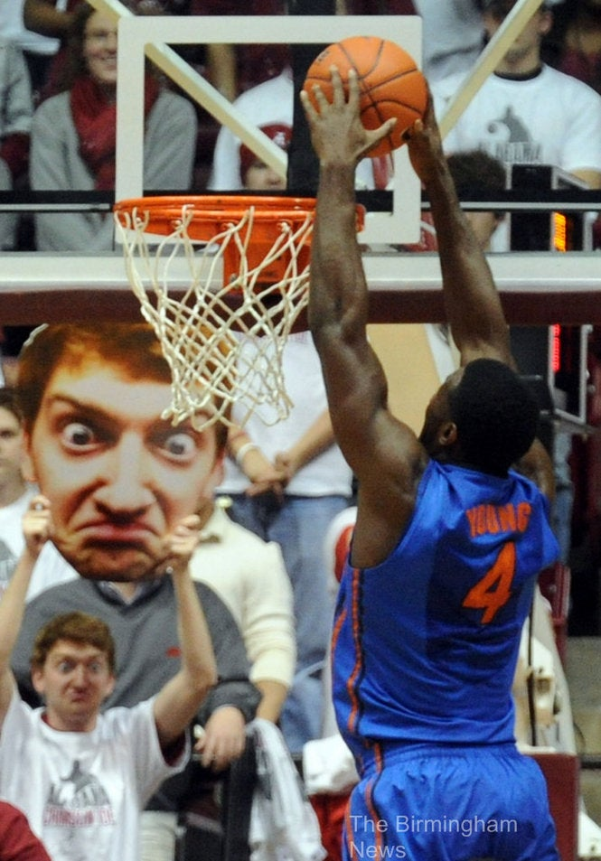 This Alabama Fan Holds A Giant, Bug-Eyed Cutout Of His Face At Games, And We're Scared
