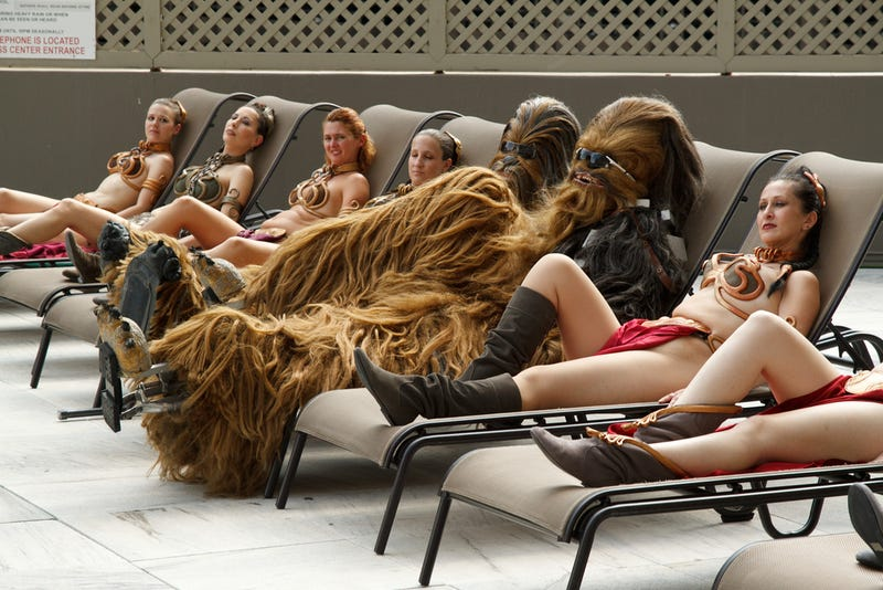 And now, two Chewbaccas lounging with six bikini Leias by the pool