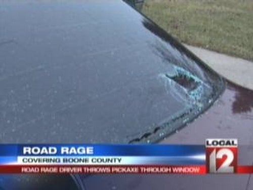 Road-Ragin' Nut-Job Throws Pick Axe Through Car Window