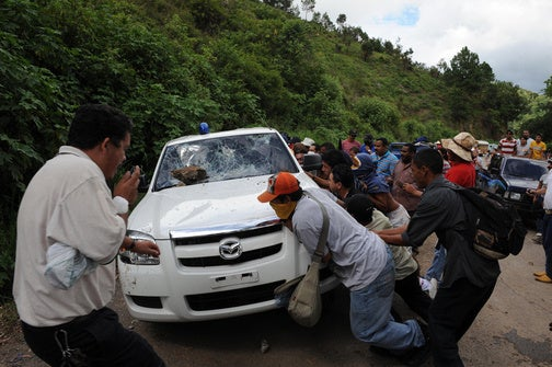 Why You Shouldn't Drive Your State Police Car To A Honduran Protest Rally