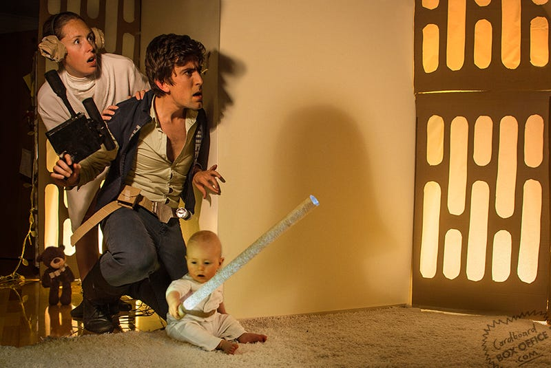 Parents recreate movie scenes with their baby and a lot of cardboard