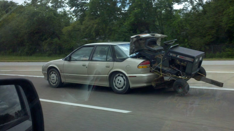 How not to haul a riding lawnmower with a Saturn
