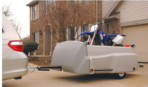 Tow-n-Stow Trailer Doubles As a Storage Unit In the Garage