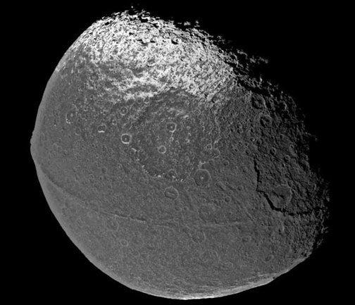 Saturn's Mysterious Splattered Moon