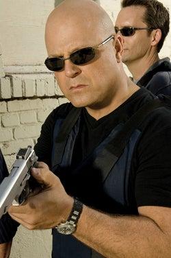 DC Lawmaker Wants Cop Guns to Have Mini FPS Cameras