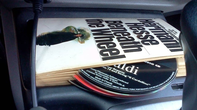 Hold Loose CDs in a Book for Easy Transportation
