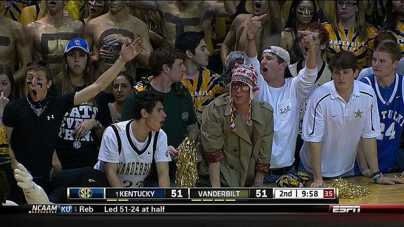 Kentucky-Vanderbilt Featured Your Standard Kid Flipping The Bird Next To A Guy In A Fuzzy Winter Hat With A Trench Coat Shirt And Mirrored Glasses