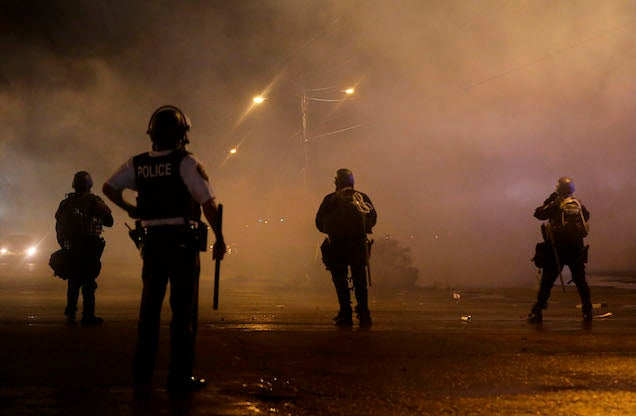 Seven Arrested and One Shot in Ferguson After First Night of Curfew
