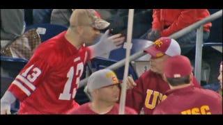 What Is This Nebraska Fan Doing?