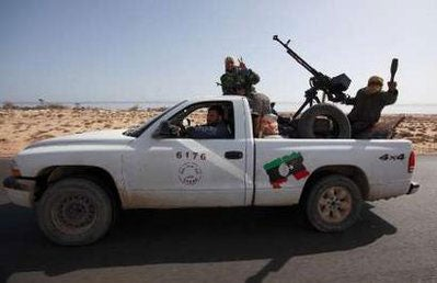 These Libyan Rebels prefer an American pickup truck