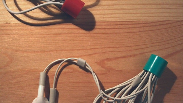 Stuff Headphone Cables Into a Chapstick Cap for Tangle-Free Storage