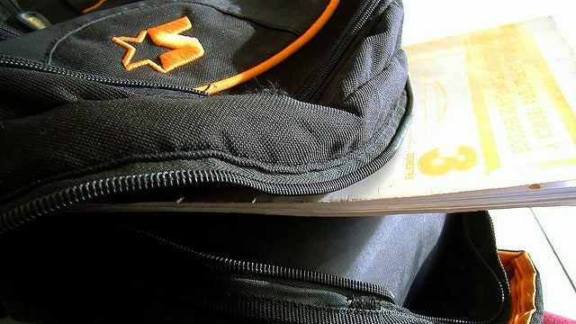 Keep Your Heavy Book Bag Tightened Against Your Body to Reduce Injury