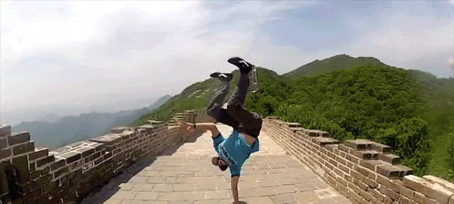 Awesome guy does awesome hand stands in awesome places on awesome trip