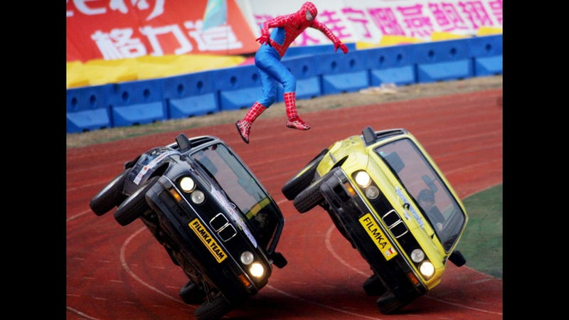 Why is Spiderman jumping between these speeding BMWs?