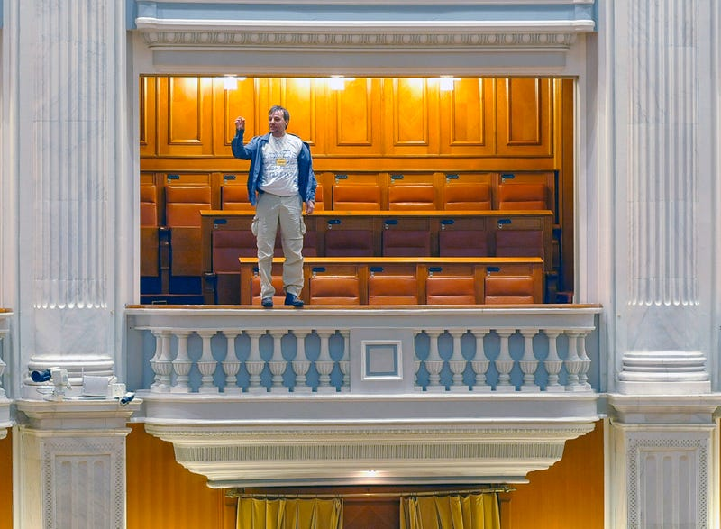 Romanian Parliament Session Interrupted by Balcony Jumper