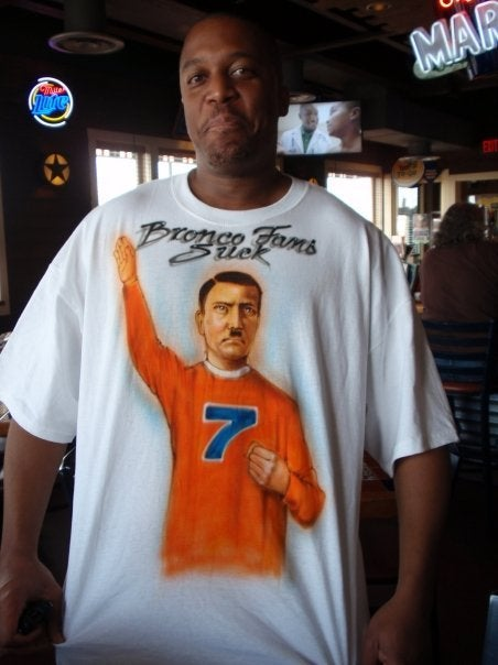 For Your Consideration: A Man Wearing An Airbrushed T-Shirt With John Elway As Adolf Hitler