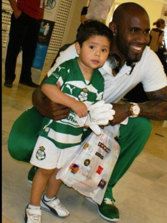 Soccer Player Takes Photo With Adorable Child—And Playboy Magazine He Just Bought