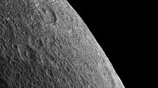 A Rare Glimpse Of Rhea's Warped Horizon