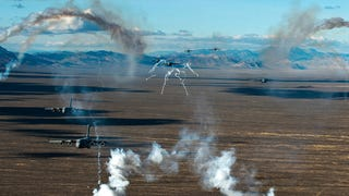 Seven C-17 Globemaster IIIs deploy flares over the Nevada Test and Training Range on Nellis Air Force Base. The photograph was taken during the U.S. Air Force Weapons School's Joint Forcible Entry Exercise 14B on December 6th 2014. Have you seen a better promise of air power recently? [Senior Airman Thomas Spangler/U.S. Air Force]