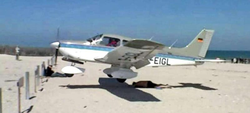 Extremely Close Call As Plane Nearly Runs Over Sunbather