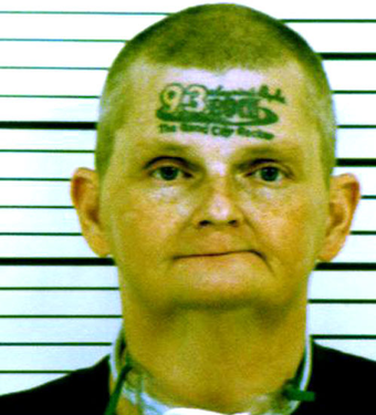 Human Billboard and Radio Laughingstock Relives Humiliation in Mugshot