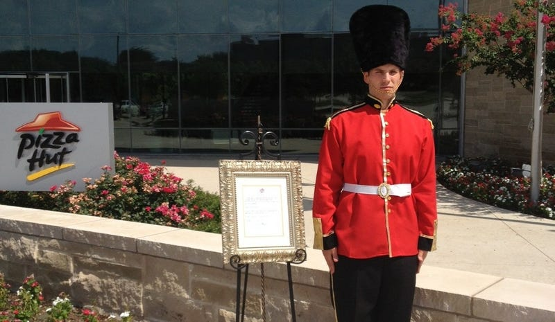 Intern Dressed as Royal Guard Stands in Stifling Heat Outside Pizza Hut