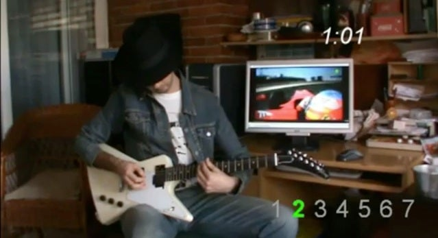 Man Imitates Formula One Car With Electric Guitar