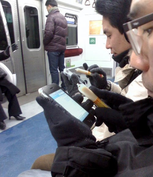 Cold Koreans Jabbing Smart Phones with Meat