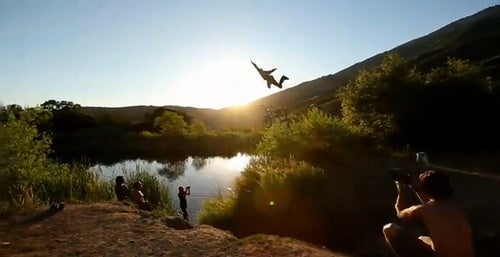 Watch Extreme Bike Jumpers Fall Into a Pond