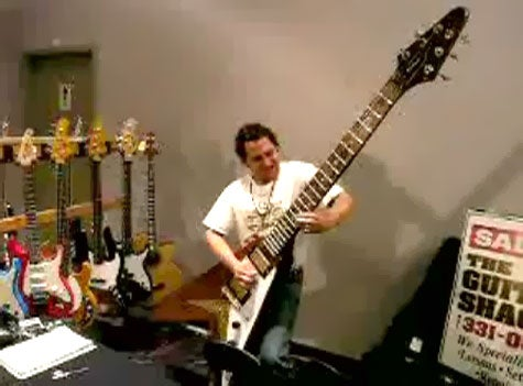 Huge Gibson Flying V Guitar In Action, Plus One That's Even Bigger