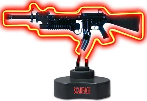 Neon Scarface Rifle Lamp Threatens Consequences Beyond Tackiness