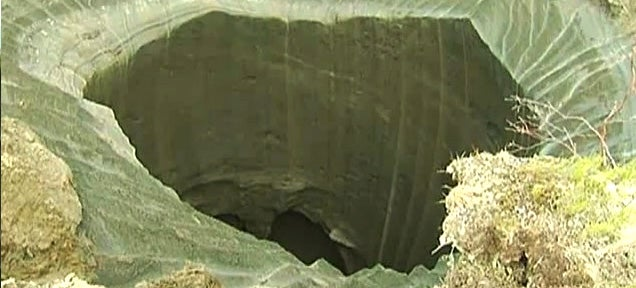 New footage of mysterious giant Siberian hole as scientists reach the site