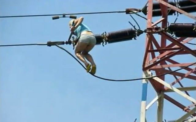 Woman Scales Transmission Tower While High as a Kite