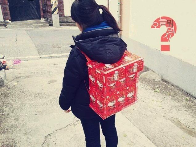 Korean Schoolgirls Wearing Backpacks Made of Junk Food