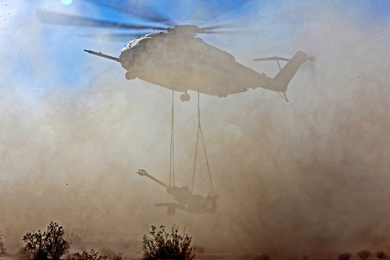 Lifting cannons with helicopters seems like a lot of fun