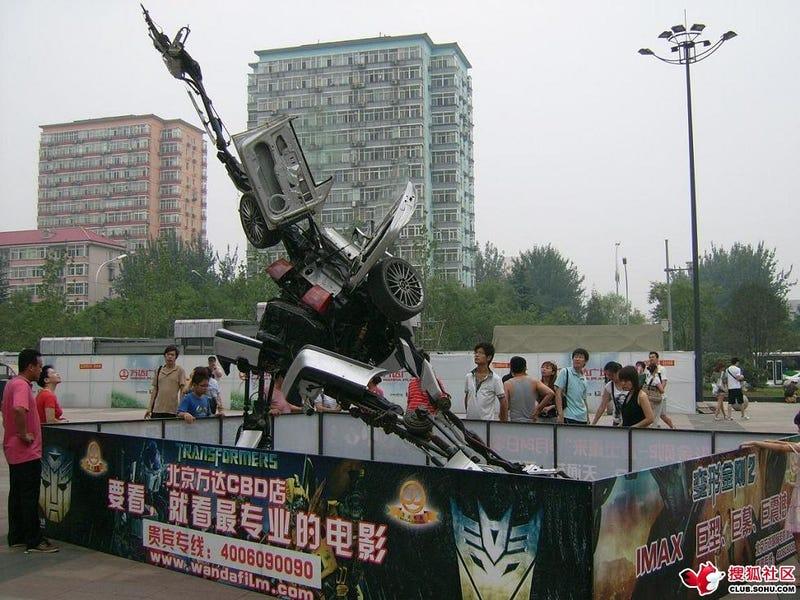 VW Passat-a-Bot Transformer Attacks Beijing Mall
