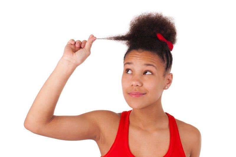 Salon Tells Black Women to 'Straighten Up' Hair