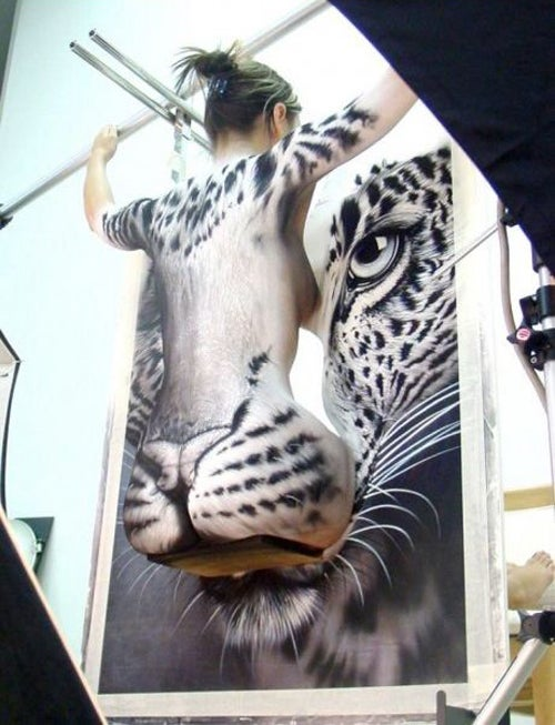 This Snow Leopard Has a Naked Lady On It