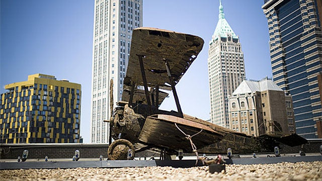 Why Is There a WWI Biplane On The Roof of This NYC Skyscraper?