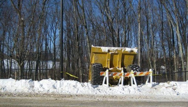 Giant Dump Truck Tries Sledding, Fails Miserably