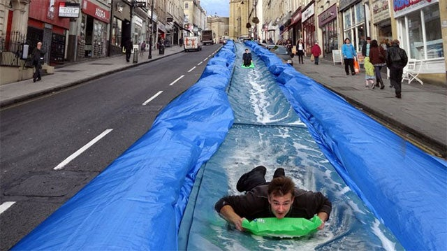 Help A Man Build A 300-Foot Water Slide In The Middle Of A Road