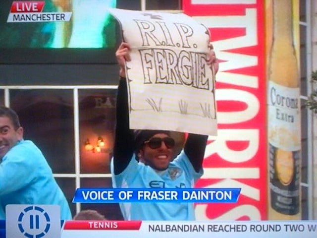 "Carlos Tevez Happily Wields ""R.I.P. Fergie"" Sign At Man City's Parade"